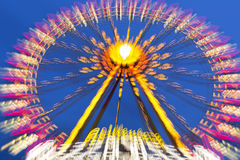 Big wheel on a fun fare. Shot taken with intentional camera movement (ICM Stock Photos
