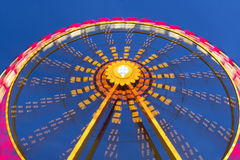 Big wheel on a fun fare. Shot taken with intentional camera movement (ICM Royalty Free Stock Photos