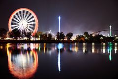 Big wheel on funfair with reflexion in river Stock Photos