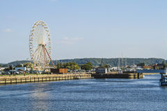 The big wheel in the harbor Stock Photography