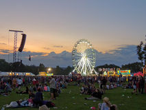 Big Wheel at the Isle of Wight Festival. The Big Wheel, crowds and lighting equipment at The isle of Wight Festival, June 2014. the evening draws in as the light Stock Image