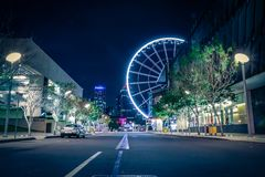 Big wheel in lights on dark street royalty free stock photo