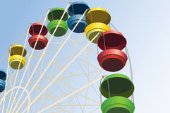 Big wheel with multicolored cabins  Stock Images