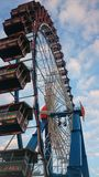 The Big Wheel at the Oktoberfest. A picture from under the wheel Stock Photo