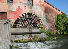 Big wheel of an old abandoned water mill Royalty Free Stock Photography