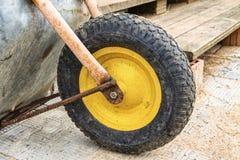 Big wheel of an old metal cart close-up stock image