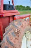 Big wheel red tractor. With dry mud on Stock Photo