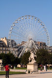 Big wheel and statue Royalty Free Stock Image