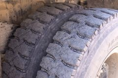 Big wheels for the dump truck. Large used wheels for articulated dump truck stock photography