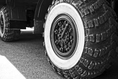 Big wheels. Modified old pickup car, on big wheels Stock Image