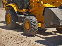 Big Wheels in Motion. The wheels of a construction Back Hoe in motion Stock Photography