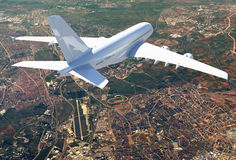 Big white airplane. Aerial view of cityscape Royalty Free Stock Images