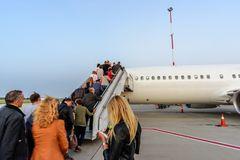 Airplane in airport ready to flying and people going up stock photography