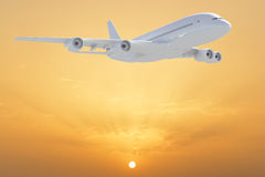 Big white airplane. Sunshine sky with clouds as backdrop Royalty Free Stock Photography