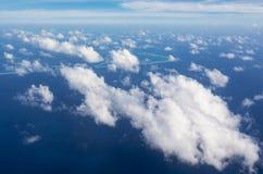 Big beautiful cloud stretched above indian ocean Stock Photos