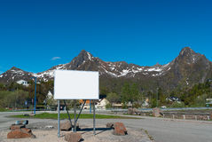 Big white bilboard on the norwegian road. In sunny day stock photography