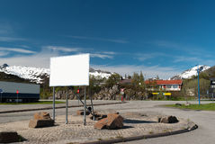 Big white bilboard. On norwegian road in sunny day royalty free stock photos