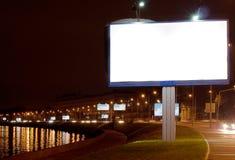 Big white bill-board on night quay. The big white bill-board on night quay Royalty Free Stock Image