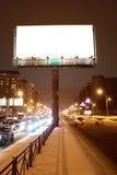 Big white billboard. On the night street Royalty Free Stock Photo