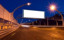 Big white billboard on night highway Stock Images