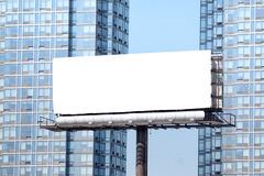 Big white billboard between towers. Stock Images