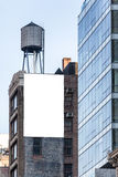 Big white billboard on the wall. Royalty Free Stock Image
