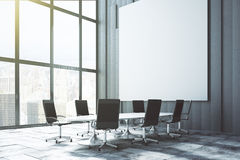 Big white blank poster on the wall in loft conference room at su Stock Photo