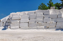 Big white blocks of raw marble in a quarry in Greece Stock Images