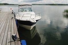 Big white boat tied up at the seashore Royalty Free Stock Image