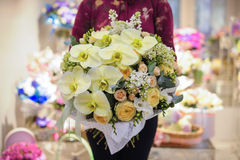 Big white bouquet with huge orchids Royalty Free Stock Photo