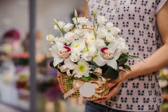 Big white bouquet with huge orchids in hands. Big white bouquet with huge orchids in woman hands Stock Photos