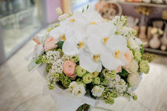 Big white bouquet with huge orchids. On table Stock Image