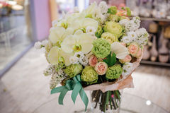 Big white bouquet with huge orchids. On table Stock Photo