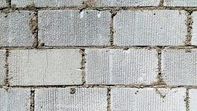 Big white bricks wall texture closeup shot.  stock photos