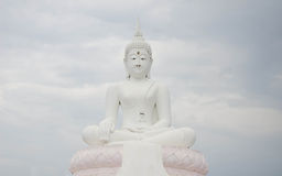 Big White Buddha. Statue on cloud background Stock Image