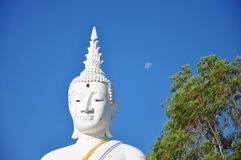 Big white  Buddha sculpture and small full moon Royalty Free Stock Photography