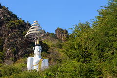 Big white buddha statue with royal umbrella Royalty Free Stock Images