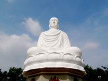 Big white Buddha statue. Standing outside under blue sky Royalty Free Stock Images