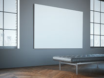 Big white canvas in the gallery with leather chaise-longue. Royalty Free Stock Image