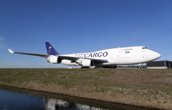 Big white cargo plane on a blue sky Royalty Free Stock Image