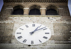 Big white clock on the facade of the bell tower Royalty Free Stock Photography