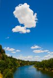 Big white cloud. Over the river Stock Image
