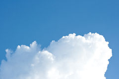 Big white cloud. On blue summer sky Stock Photo