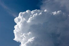 Big white cloud under the sunlight. On the blue sky Royalty Free Stock Photos