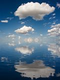 Big White Clouds. Reflected on water Royalty Free Stock Images