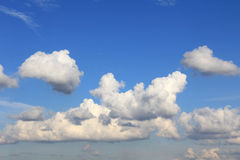 Big white clouds in blue sky Stock Photos