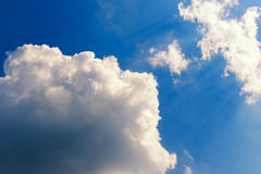 Big white clouds on the blue sky, lit by the sun. Copy space. Abstract sky Royalty Free Stock Photography