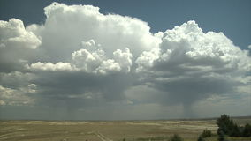Big white clouds forming across open lands. Video of big white clouds forming across open lands stock footage