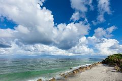 White clouds over Gulf of Mexico from Caspersen Beach in Venice Florida stock photos