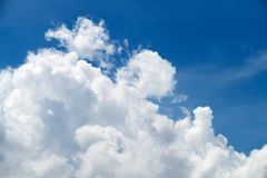 Big white cloudy and blue sky,. Summer season Royalty Free Stock Images